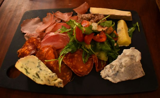 Mixed charcuterie and cheese board