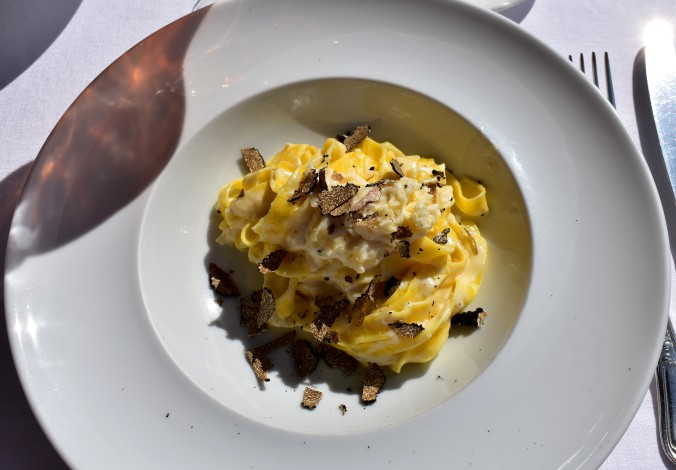 pasta in a cheese sauce with shavings of truffle.